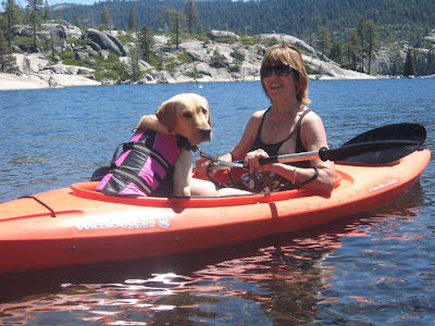 Mary and yellow Lab Persia in kayak