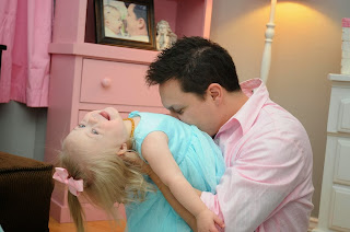 Shawn Basile plays with his daughter Mila. Mila and her sisters Zoya and Sofia were adopted from Ukraine.