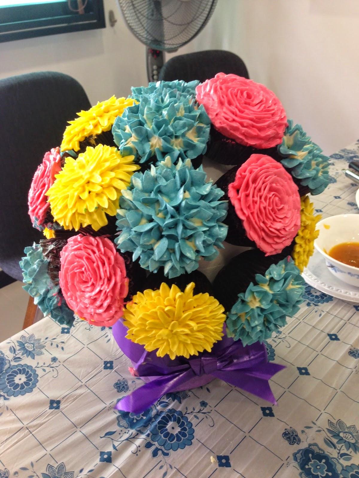 Macarons a cupcake flower bouquet crissas cake corner cupcake flower bouquet izmirmasajfo Image collections