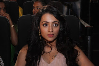 Trisha in a Brown Sleeveless Floor length Evening Gown at Thoongavanam Audio Launch
