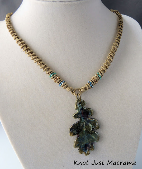 Spiral micro macrame necklace with raku leaf pendant