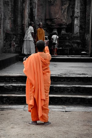 Monk taking photographs