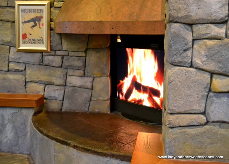 the faux fireplace at St. Moritz Cafe