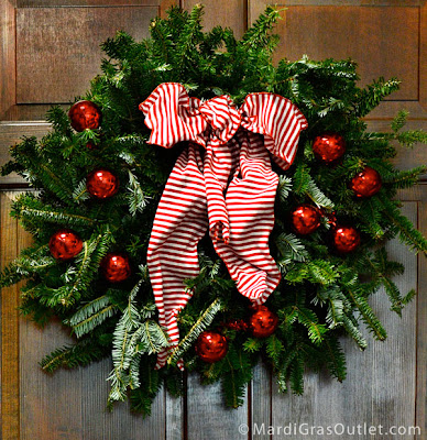 Plain Frasier Fir wreath decorated with tinsel ball ties and bow