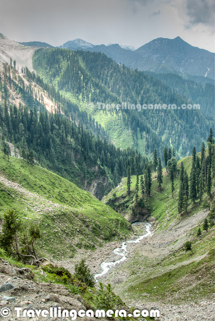 Jammu & Kashmir Tourism Department and state government are working hard to develop new tourist circuit around Old Mughal Road.  In same endeavor, they keep organizing various events around old Mughal Road which is almost complete and only few stretches are under progress.  This Photo Journey shares some of the landscapes shot around Old Mughal Road in KashmirMughal road brings the Poonch and Rajouri district closer to Srinagar in Kashmir valley. The distance between Srinagar and Poonch is reduced from 580+ kilometeres to 125 kilometers. Mughal Road makes for alternate road route to Kashmir valley from rest of India, other than over-crowded Jammu-Srinagar Highway through Jawahar Tunnel (Banihal Tunnel) (National Highway 1A). Mughal road passes through Buffliaz, Poshana, Chattapani, Peer Ki Gali, Aliabad, Zaznar, Dubjan, Heerpora and Shopian.Whole stretch of Mughal Road from Jammu to Srinagar is very beautiful. Snow capped hills all around with various white water streams flowing through them and chilled wind to keep you  fresh always. We started our Road journey from Jammu and destination for the day was Srinagar.Due to extreme whether of Jammu in summers and winters it is also known as the City of Rocks. Jammu has lots of Major tourist attractions, which includes Patnitop, Mansar Lake,Surinsar Lake, Jhajar Kotli, Baag-E-Bahu (Bahu Fort), Peer Kho, Jammu Tawi and many more...Mughal Road mainly passes through Beharamagala, Chandimarh, Dograin, Chatapani, Peer-ki-Gali, Dubjian, Shopian and Srinagar. There is a iron bridge after after Rajouri twon from where this Mughal Road starts. Whole Mughal Road is very side and amazingly beautiful which can't be expressed in photographs. Most of the photographs shared here are shot from moving car... At some spots we stopped and clicked few ones, although it was extremely difficult to resist from stopping the car after interval of every 5 minutesEvery turn on Mughal Road was coming with pleasant surprises. After Rajaouri, elevation level started increasing continuously till Peer-Ki-Gali. On the way, many times we were welcomed by clouds... Looking through these deep valleys was an amazing experience which is not possible to simulate through these photographs. One has to go to the place for experiencing the real nature and wish that place remains the same even when tourists start visiting it frequently.  Here is a view of another deep valley, which can be seen from Peer ki Gali. Peer Ki Gali is one of the most beautiful places on Mughal Road with lush green hills all around with shining white snow on the tops. Water Streams and Waterfalls flowing all around. It was very normal to see these clouds all around the Mughal Road. Kashmir is generally very beautiful and many folks visit places like Srinagar, Pehalgaon, Gulmarg etc, but Mughal Road is going to become another big tourist destination. There are few patches under progress and hope to complete soon.After high hills of Peer Ki Gali, we start driving down towards the valley which passes through Shopian. Shopian region is again very beautiful & dressed with colorful apple orchards. Houses around Shopian were amazing - mainly two storied buildings with slanting roofs & some of them plastered with mud paste. Wood is heavily used in Kashmiri houses...Mughal road was historically used by Mughal emperors to travel and conquer Kashmir during the sixteenth century. Old Mughal Road was the route used by Akbar the Great to conquer Kashmir in 1586, and his son Emperor Jahangir died while returning from Kashmir on this road near Rajouri.Mughal Road is the road between Bafliaz, which is a town in the Poonch district, to Shopian district in the Kashmir valley. The road is 84km long and situated in the Jammu and Kashmir state of India. Mughal Road passes over Pir Panjal Mountain range, at altitude of 11500 feets that is higher than Banihal pass..Here is a photograph of Paddy fields in Rajouri District of Jammu & Kashmir state in India. Rice of this region is quite popular in different parts of the country. Most of the agricultural land was occupied by green paddy. I find all Kashmiri names interesting - Pulwama, Pampore, Kulgam, Bijbehara, Anantnag etc... Wheat is the main staple food with significant proportion of people associated with rice. Jammu is nationally and internationally famous for its Rajma Chawal which is Red Kidney Beans and Rice. But after the migration of Kashmiri Pandits in 1987, Rice is also getting famous around the area. basmati Rice of Jammu is exported to many foreign countries and is known for its distinct taste and smell.After wonderful drive through Mughal Road, we reached Srinagar Golf Course which is near to Nageen Lake of the town, Above photograph shows Golf Club building and opposite to it was Golf Course. Kashmir, which is also known as heaven on earth, offers a unique opportunity to play golf in wonderful surroundings, where the wind whispers through enormous trees of chinar and stately pine. There are various popular places in Kashmir to Golf & Gulmarg one is one of the most popular in the country.   In the verdant golf courses at Srinagar and Gulmarg, it's easy to play for longer hours than you can in the plains because of the lower temperatures – Srinagar's highest temperature seldom goes above 35°C. During the summers, while the plains are boiling, Srinagar's temperate climate allows the golfer to play longer hours without getting tired. During winters, the courses in Srinagar are closed only when snowbound. Above Golf Course is very well placed inside the town.Again a photograph of Srinagar Golf Course with green hills in the background and dense clouds roaming all around..Kashmir has been rightly called paradise for Nature lovers & Travellers with a network of rivers and streams as well as high altitude lakes all abounding in trout both brown and rainbow.Trout fishing in Kashmir is one of the most popular activity and quite known in various parts of the world. Department of Fisheries, which controls angling in the valley,works hard to ensure that there is no depletion of stock by indiscriminate fishing which means that you can revel in angling in ideal conditions. Various tourists and localities can be seen around Dal Lake doing fishing.