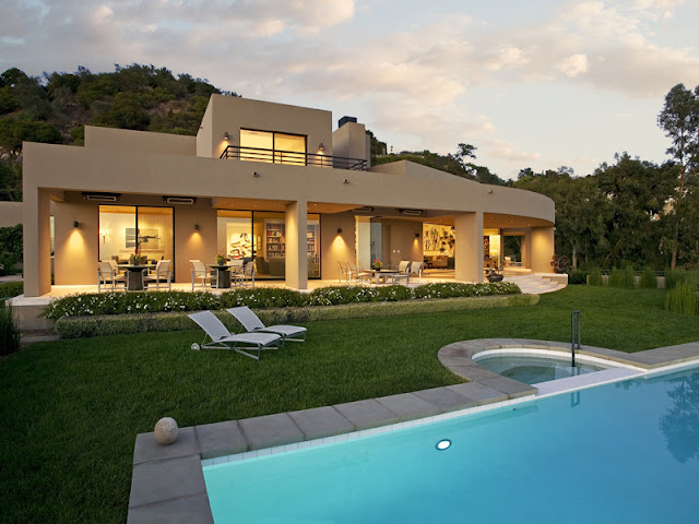 Photo of amazing home as seen from the pool area