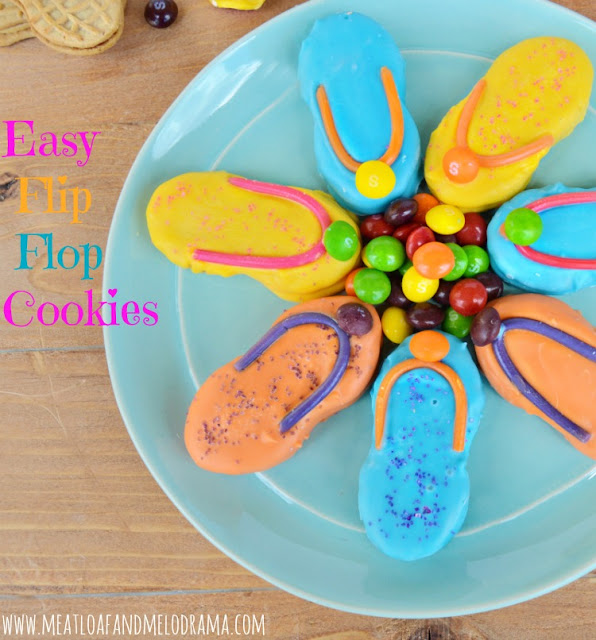 flip flop cookies with skittles candy beach ball on a plate