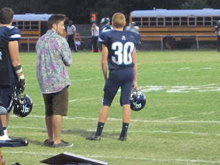 Photo of Coach's sponsor, #30 Austin as he waits to be called out on the field to kick.