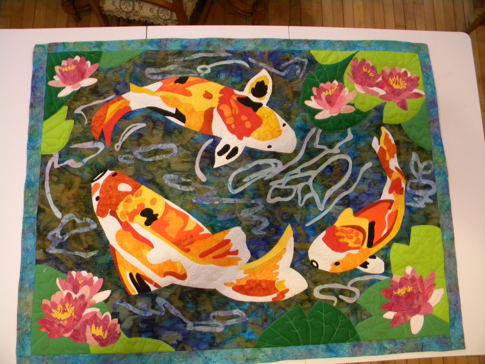 Laura 39 s fiber art world done with koi pond quilt for Koi pond quilt pattern