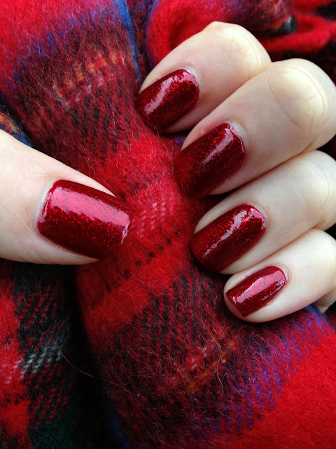 Swatches of China Glaze's 'Ruby Pumps' on the nails.