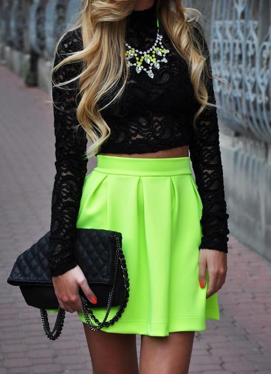 Neon mini skirt, black top fashion trend