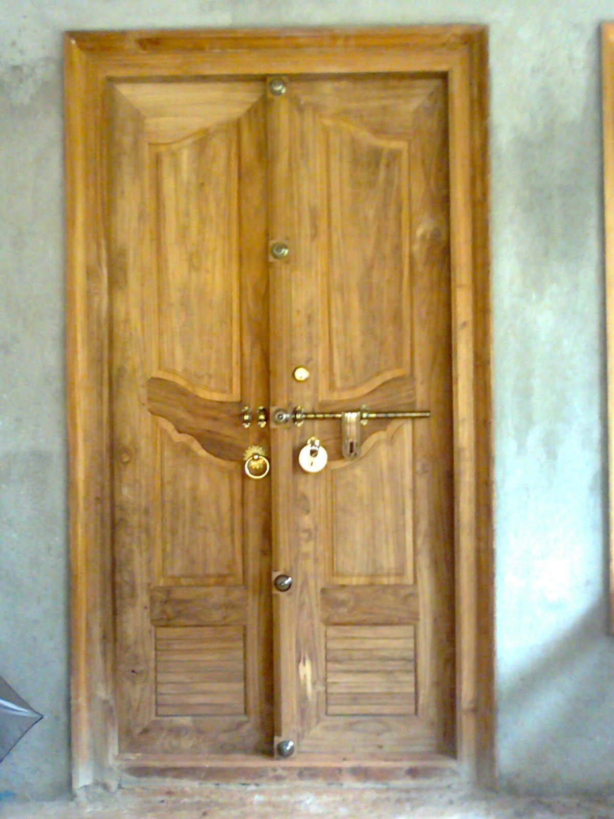 Kerala style wooden front door double door designs bavas for Door pattern design