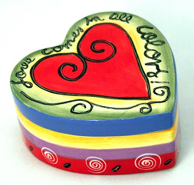 hearr-shaped trinket box, says Love comes in all colors.