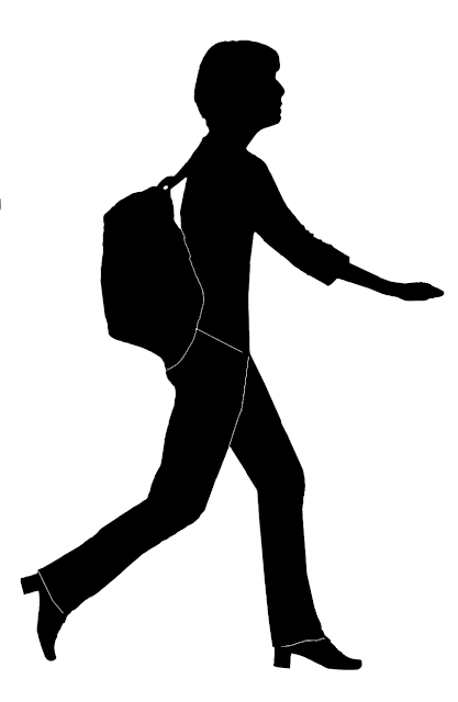 silhouette of a woman walking quickly with haversack