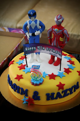 Birthday Cake Center: ultraman and blue power rangers cake..