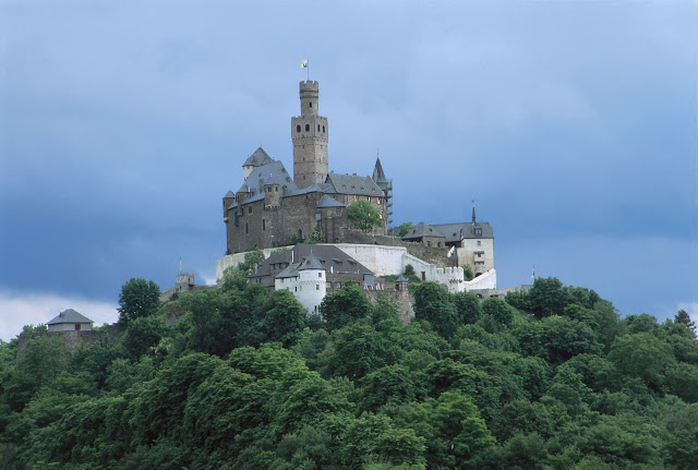 The formidable 700-year-old Marksburg Castle rises above the town of Braubach where the Mosel meets the Rhine. Photo: © German National Tourist Office. Unauthorized use is prohibited.