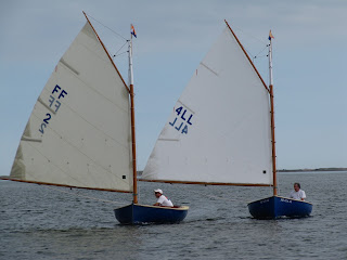 Two Classic Ca catboats under sail