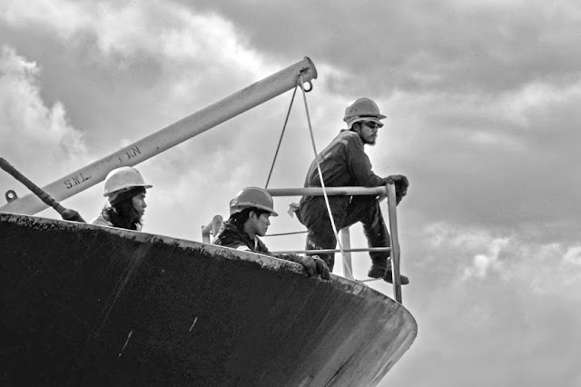 Crew on the bow of their ship in harbour of Terneuzen