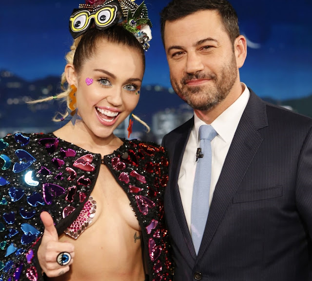 Miley Cyrus Exposing her tits boobs tiny tits cleavages at on a live TV Show   Jimmy Kimmel Live in Hollywood