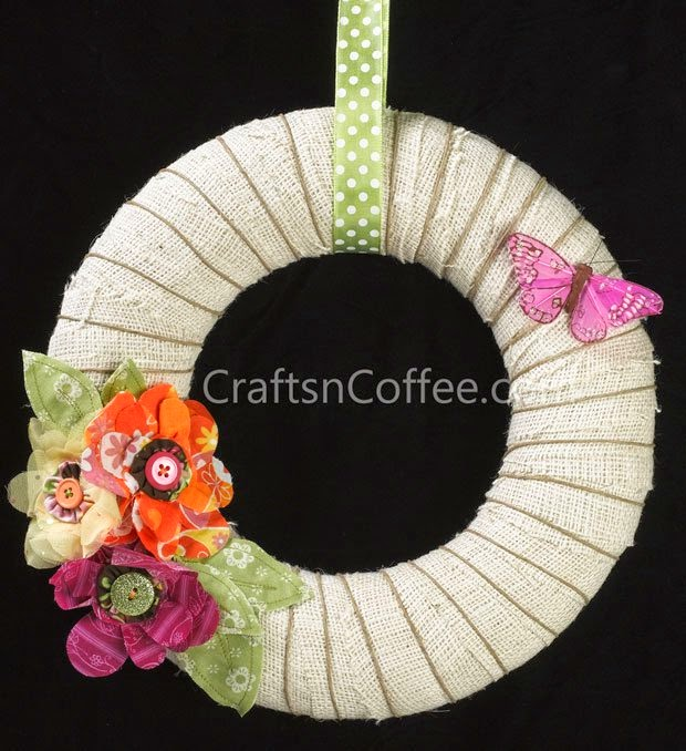 http://craftsncoffee.com/2012/05/29/make-a-burlap-twine-butterfly-wreath-to-celebrate-summertime/