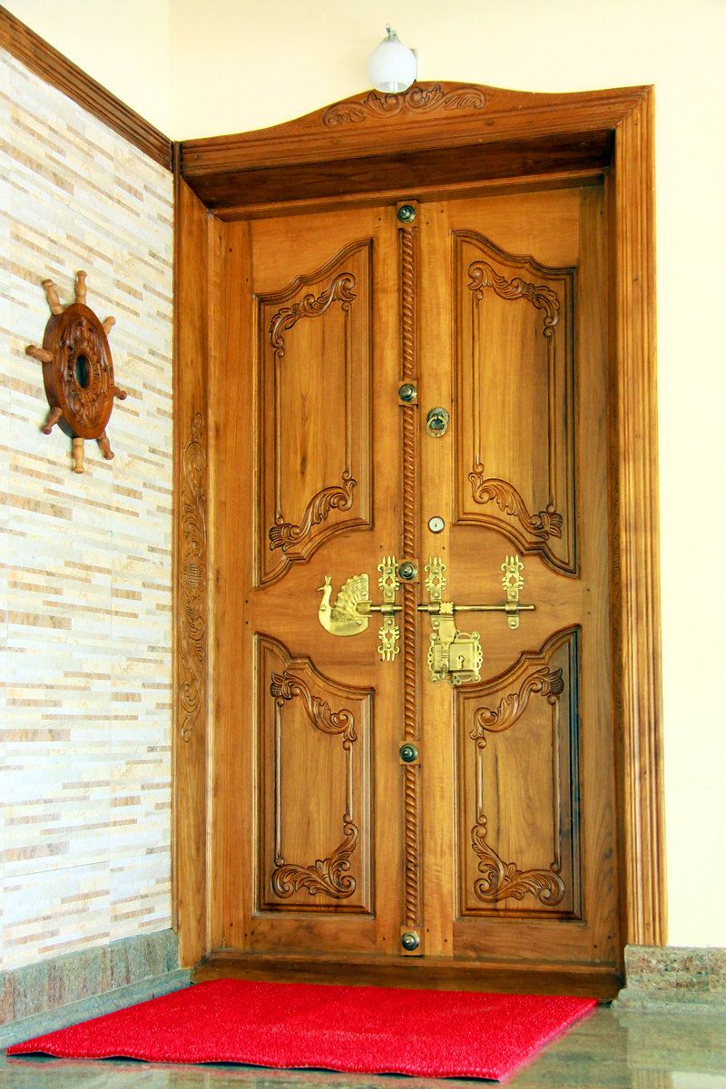 Kerala wooden door designs pictures caputcauda solid panel for New house door design