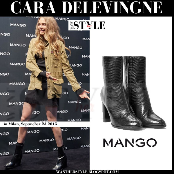 Cara Delevingne in khaki jacket and black shiny mango ankle boots event milan what she wore