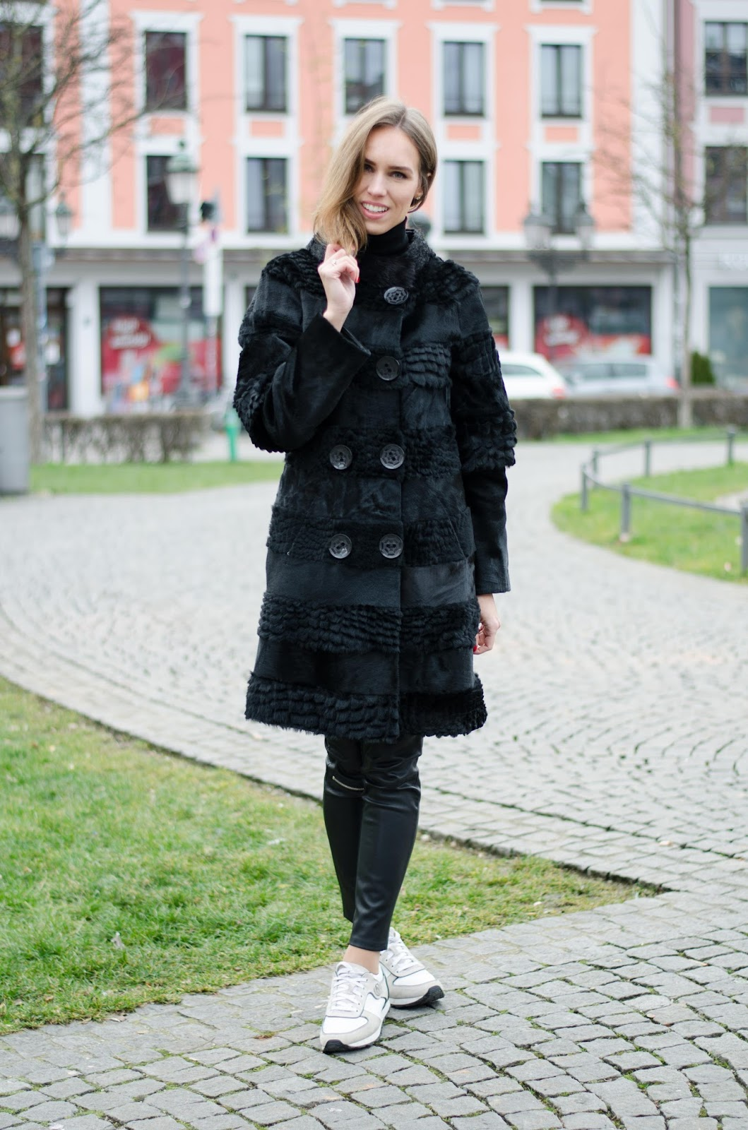 kristjaana mere textured black fur coat white sneakers casual minimal winter outfit