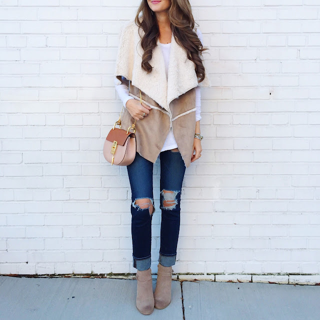 Love the shearling vest
