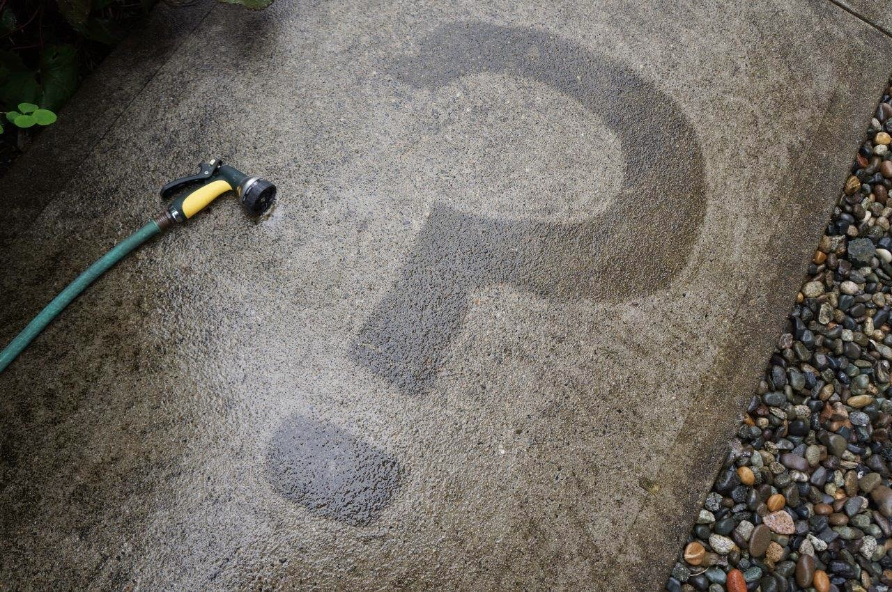 Sidewalk slime art - design by pressure washing.