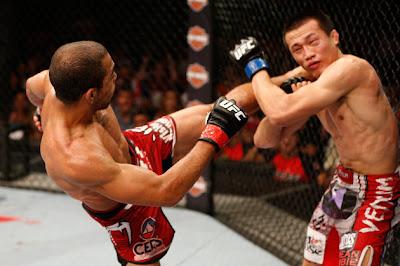 Jose Aldo kicking Korean Zombie Chan Sung Jung's dislocated shoulder in UFC 163