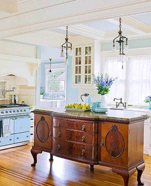 (Source). A Pretty Antique Turned Kitchen Island.