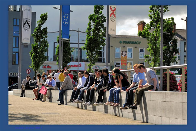 people sitting in Eyre square Galway