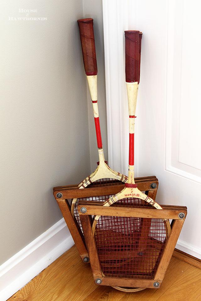 Vintage badminton racuets in an eclectic vintage entryway via houseofhawthornes.com