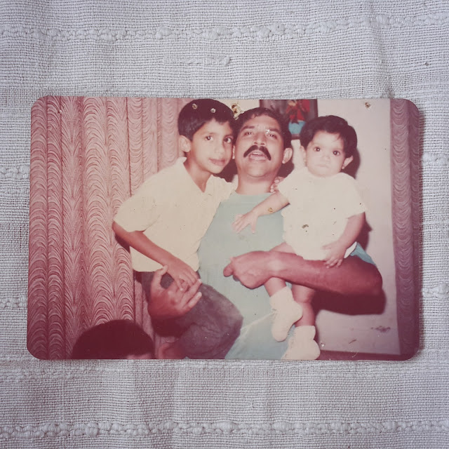 Childhood photograph of Dayle Pereira, blogger at Style File as a baby with he father and brother