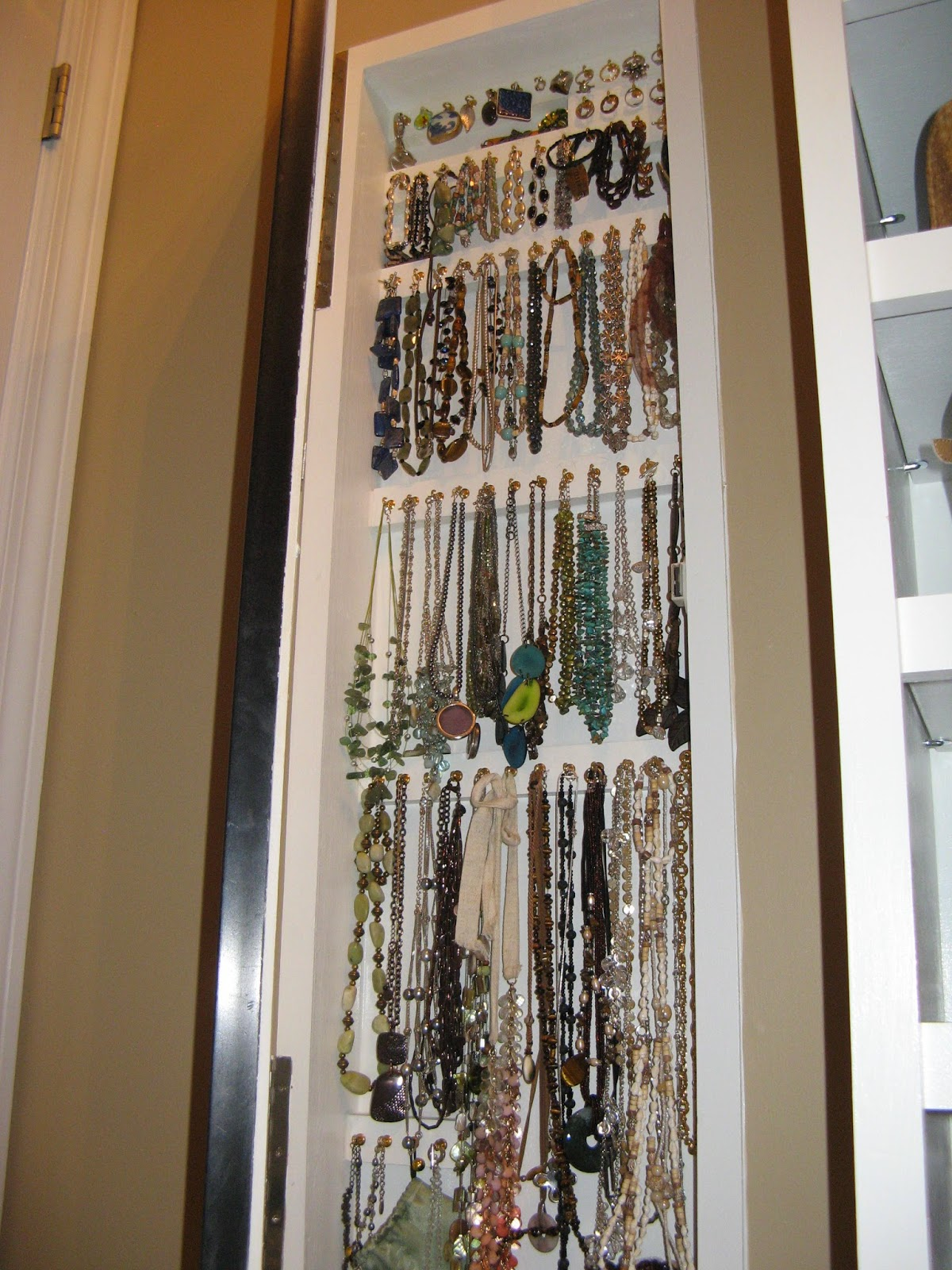 14 Closet Organizing Tips - JEWELRY CABINET