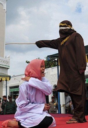 Woman-Whipped-Publicly-In-Indonesia-Under-Sharia-For-Being-Close-To-A-Man