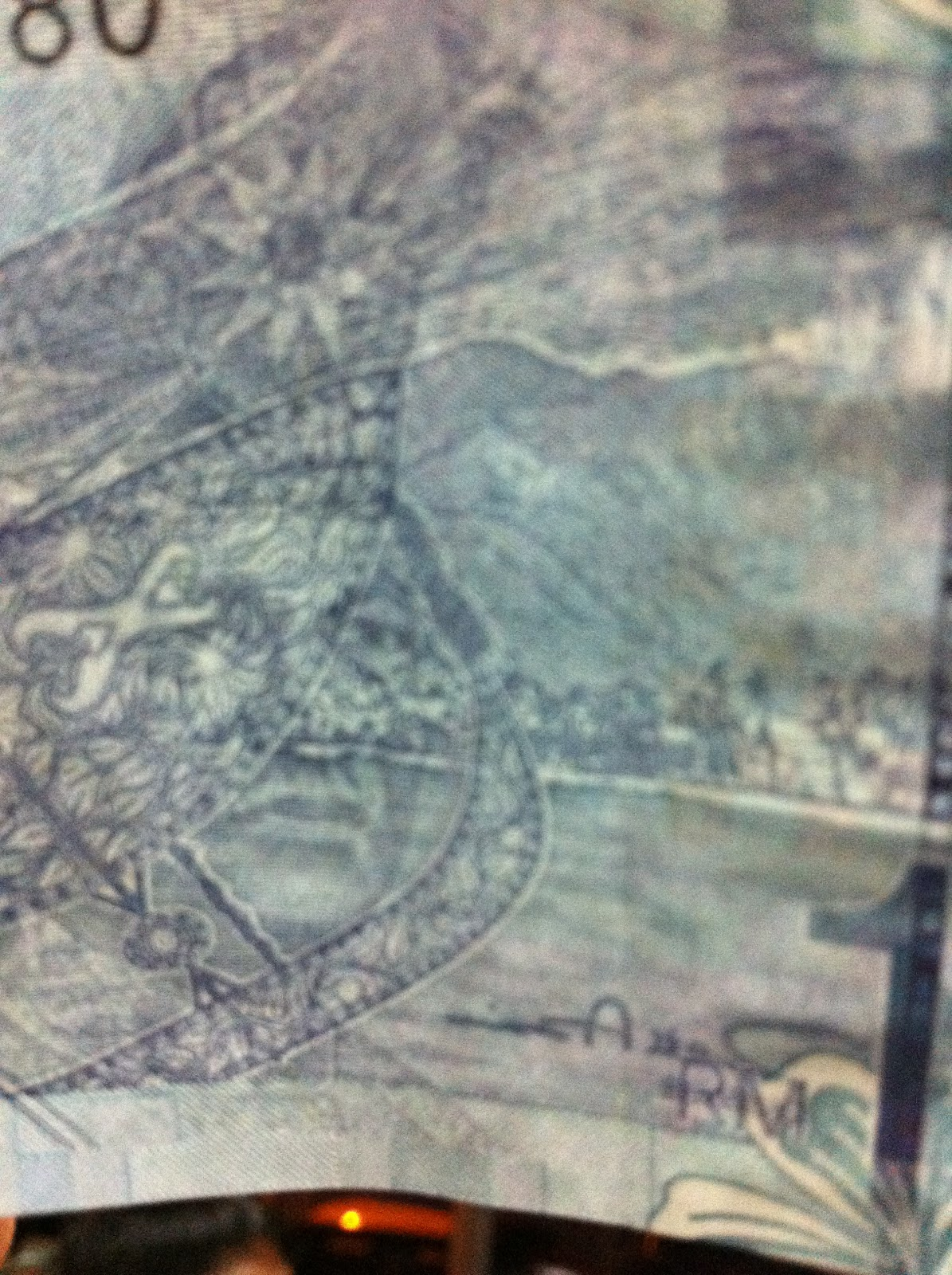 Illuminati symbol in rm1 note in the name of search now have a closer look at the triangle when light is directed on the note from behind you will be able to see the front of the note with the picture of biocorpaavc