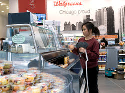 OmniChannel consumer shops for fresh food at Walgreens.