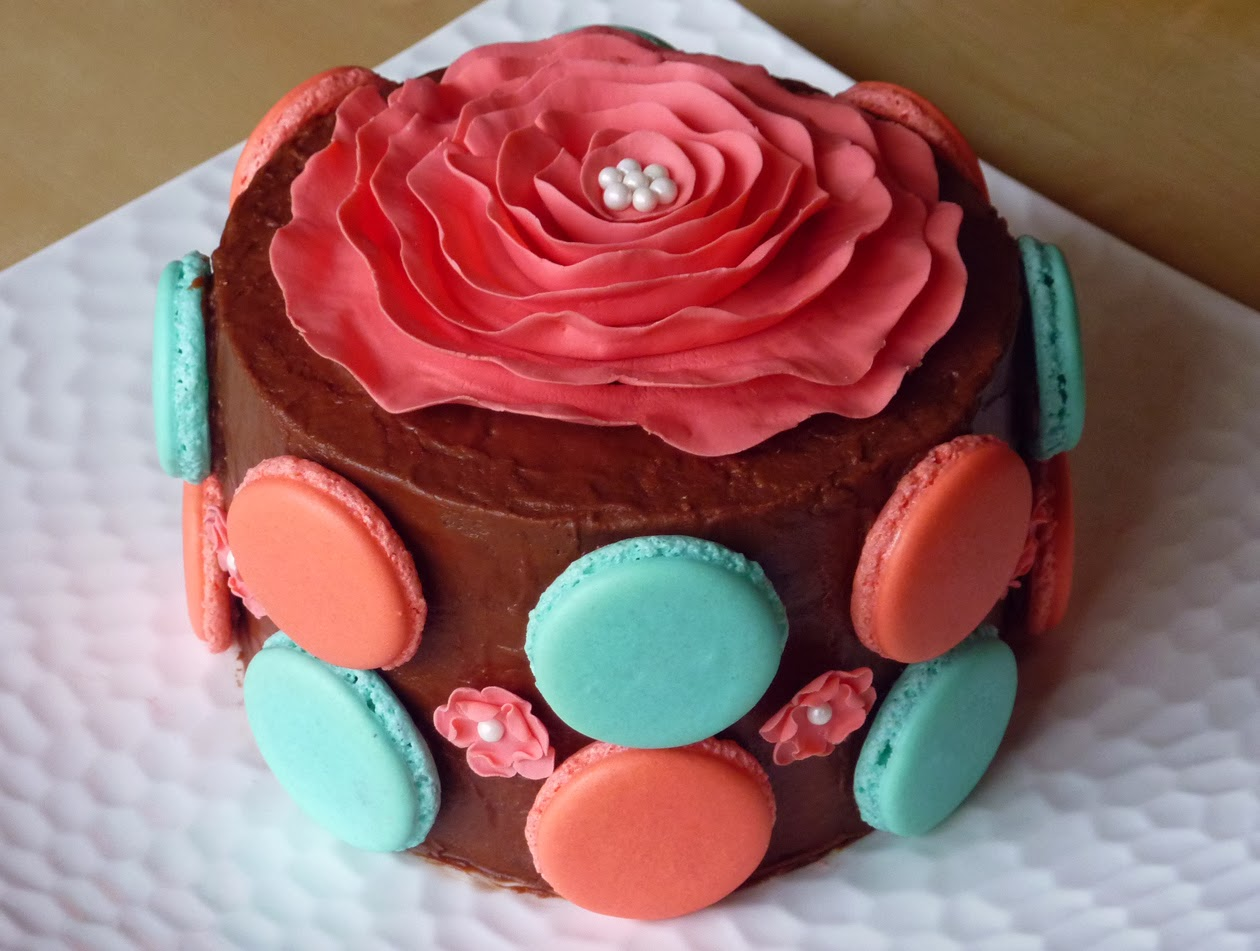Chocolate cake with peppermint buttercream filling, fudge frosting and macaron shells