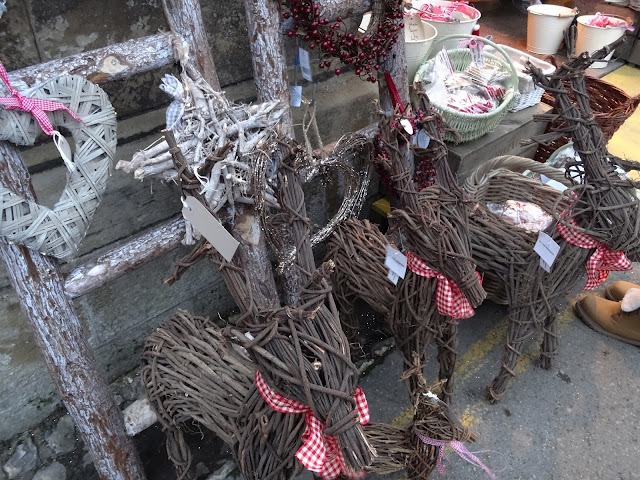 Sweet reindeers made from branches and decorated with ribbon