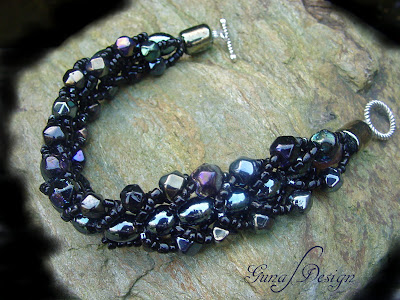 Handmade beaded bracelet from black glass beads made by Gunadesign