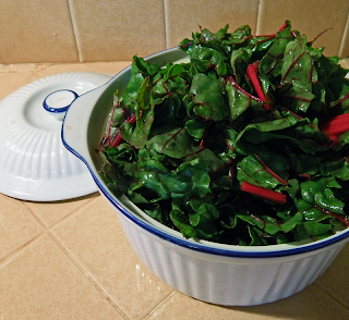 Baking Dish Overflowing with Chard Leaves