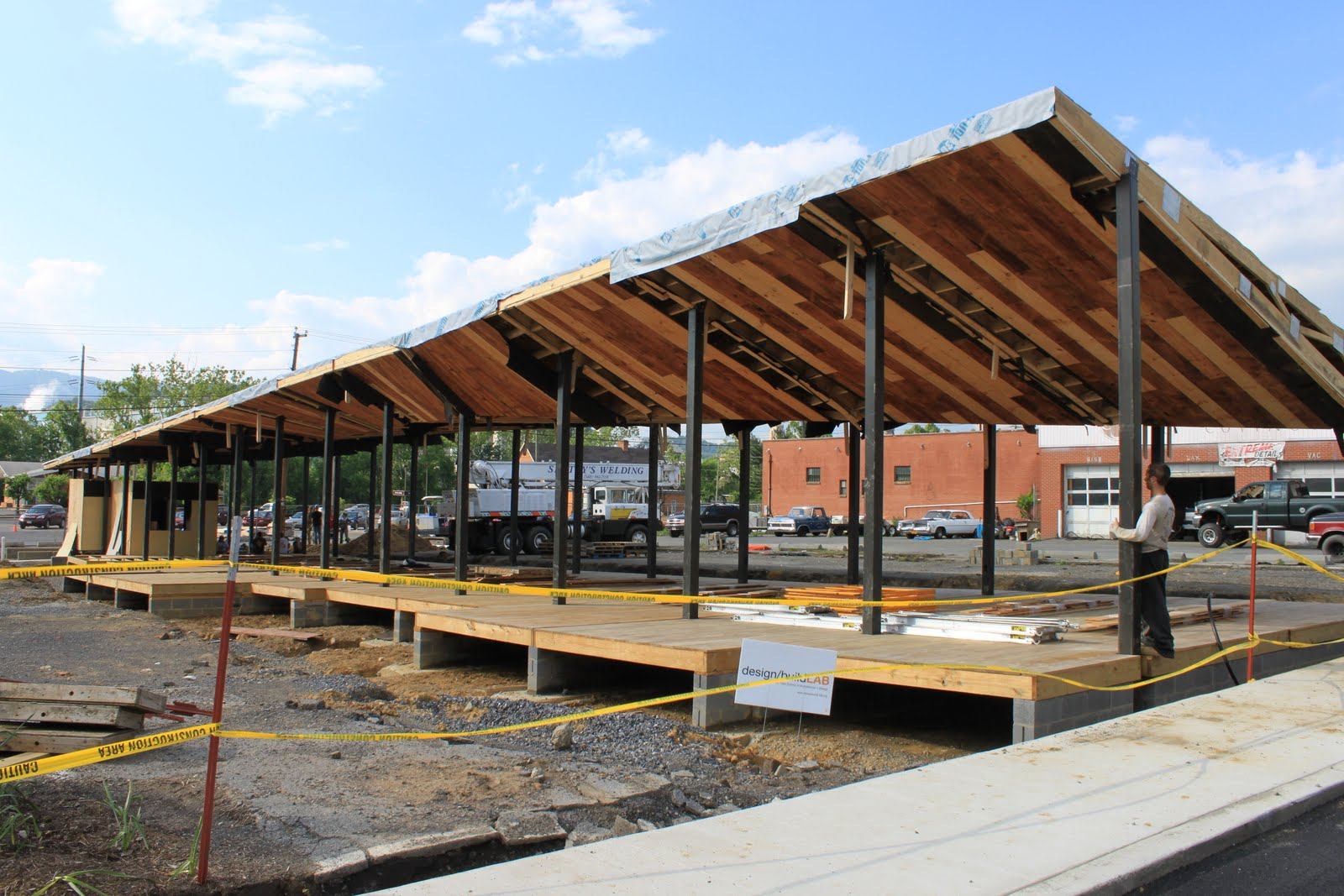 The roof was finished being fully installed on Friday evening. This photo shows the roof stretched along the length of the market space from Main St. where ... & design/buildLAB: Roof Installation Phase II memphite.com