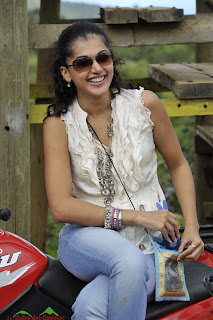 Tapsee Panu Spicy Cute Pictures in White Top Riding a Bike