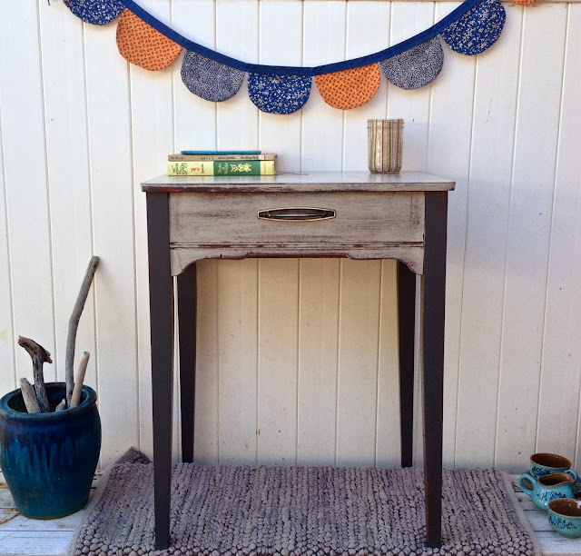 antique seing table grey with bunting books
