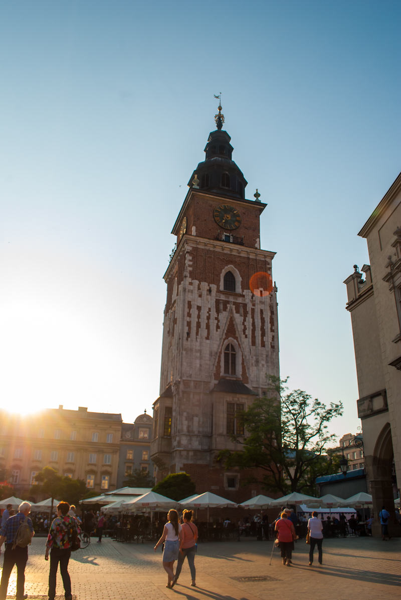 sunset over the clock tower in  Kraków, Poland