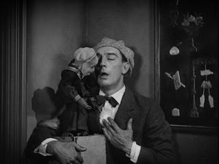 Buster Keaton with a monkey in The Cameraman