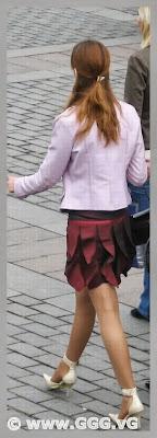 Girl wearing white high heels shoes