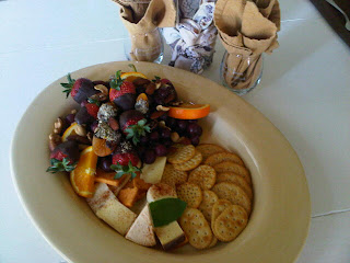 platter of fruits, cheese and crakers