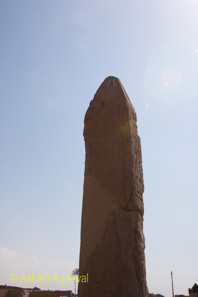 A pillar with carvings at the Karnak temple in Luxor, but worn away due to the depths of time